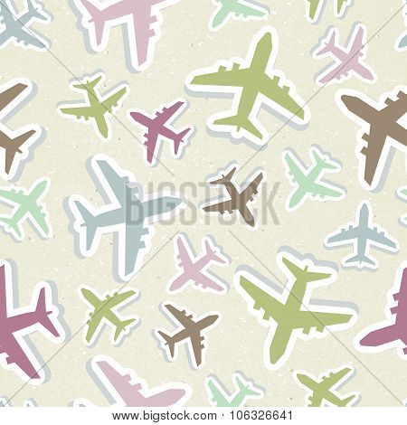 Seamless vector pattern with colorful airplanes in pastel colors.