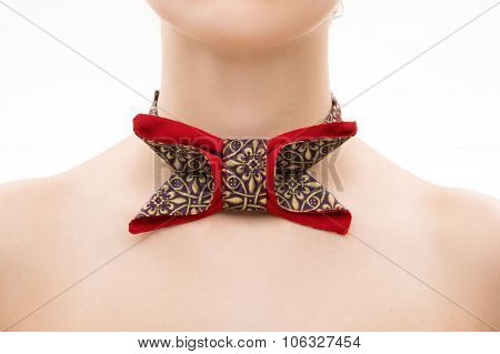 patterned tie bow on female neck.