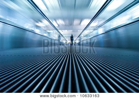 motion blur of moving escalator in airport perspective view (ground level)