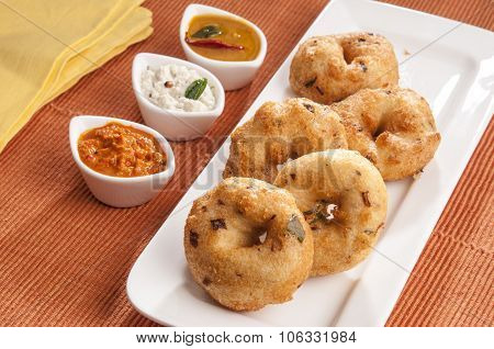 Vada Sambar with Coconut Chutney in white dish, Indian Food