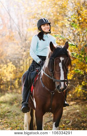 Happy woman on horseback