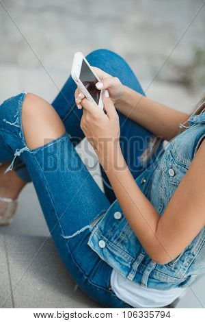 Girl listening to music,sitting on the steps
