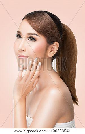 Beautiful woman cares for the skin face Beautiful Spa Woman Touching her Face Perfect Fresh Skin