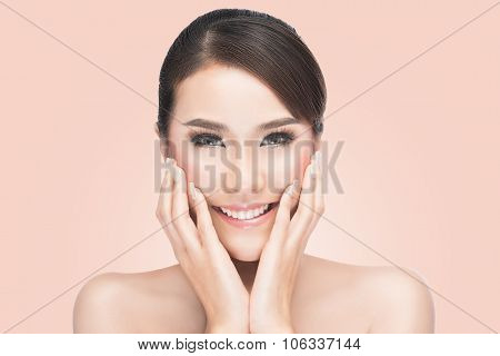 Beautiful woman cares for the skin face Beautiful Spa Woman Touching her Face