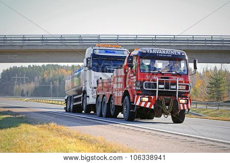 Tank Truck Being Towed By A Heavy Duty Tow Truck