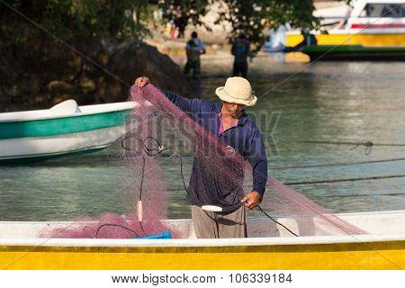 Hindu Fisherman Men Preparing Net For Fishing