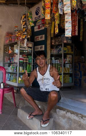 Indonesian Man In Front Of His Store In Manado Shantytown