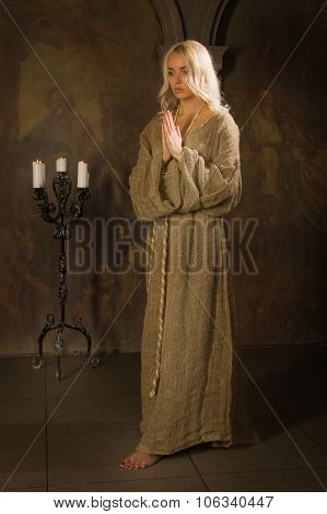 Nun Praying In A Medieval Church