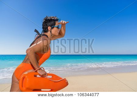 Caucasian female lifeguard on the beach