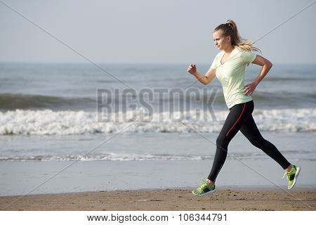 Female Runner By The Sea