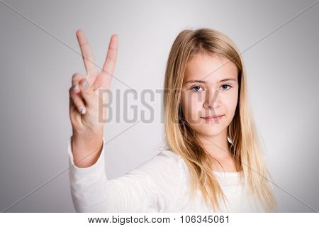 Nice Blond Girl Showing Victory Sign