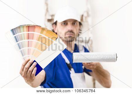 Close Up Shot Of Painter Man Showing A Color Palette