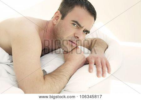Shirtless Man In Bed Looking At Camera