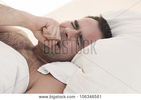 Man In Bed Yawning