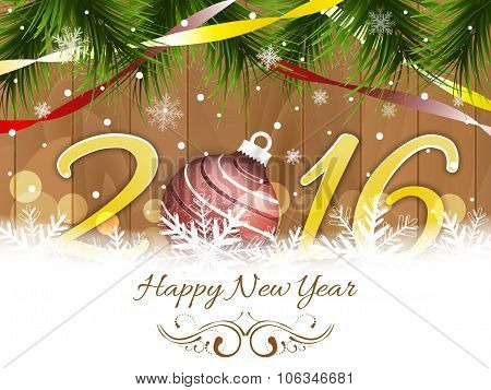 Happy New Year 2016 wishes with bauble, ribbons, snowflakes and pine-needles on wooden texture.