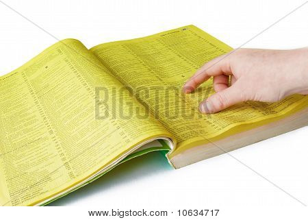 Human hand and yellow pages