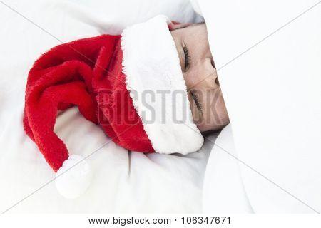 Man Sleeping With Santa Hat