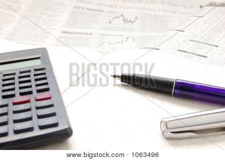Pen, Calculator And Business Paper