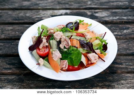 Tuna Salad With Spinach, Rocket, Red Ruby Chard, Tomatoes, Cucumbers, Carrot On Old Wooden Table