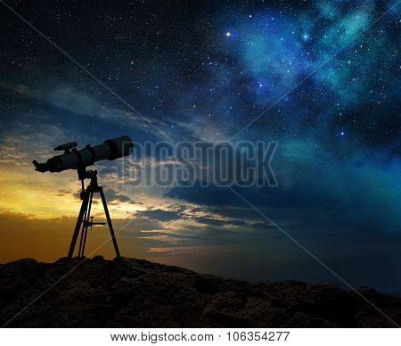 milky way and silhouette of telescope
