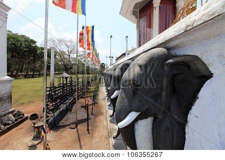 SRI LANKA - MARCH 8, 2011: Anuradhapura dagoba Ruvanvelisaya Sri Lanka, elephant heads