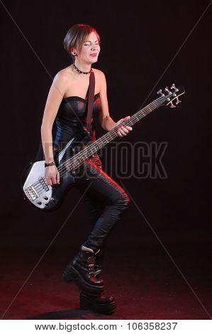 Fashion girl with guitar playing rock
