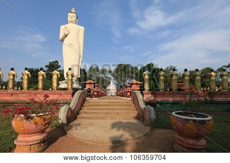 The Highest Statue Of Buddha With Golden Statues Of Monks In Sri Lanka