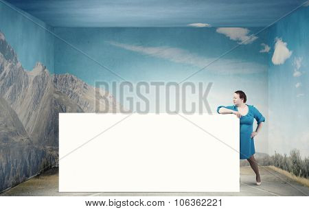 Stout confident woman of middle age with blank white banner