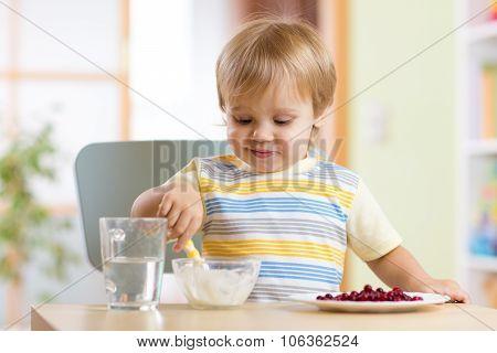 kid eating healthy food at nursery room