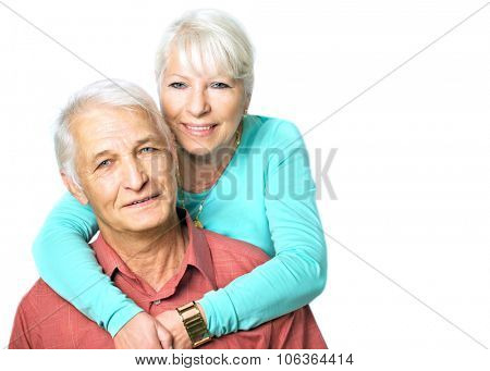 Senior woman hugging her husband from behind on white background