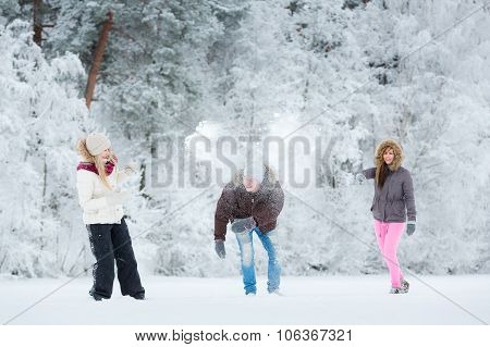 Young Adults Playing With Snow
