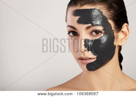 Portrait of beautiful girl with black mask clay