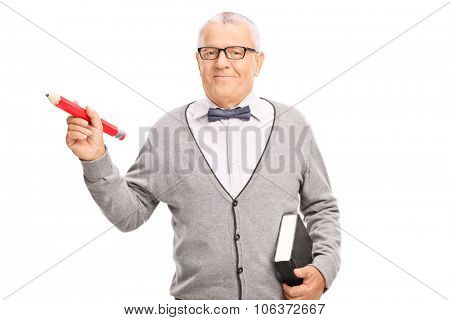 Mature school teacher holding a big red pencil in one hand and a book in the other isolated on white background