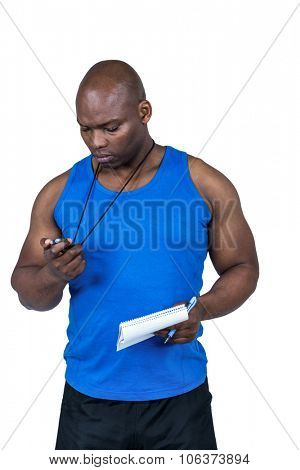 Fit trainer checking his stopwatch on white background