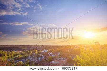 Kamianets Podilskyi cityscape under sunshine and colorful sky