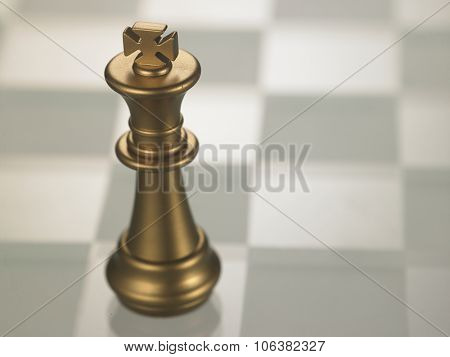 chess piece King on the glass chess board