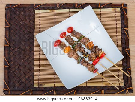 Close Up Barbecue In White Dish