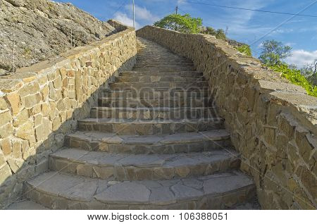 A Stone Staircase On The Hillside.