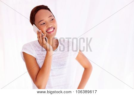 pretty afro american woman talking on mobile phone