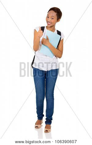 cheerful female african college student giving thumb up isolated on white