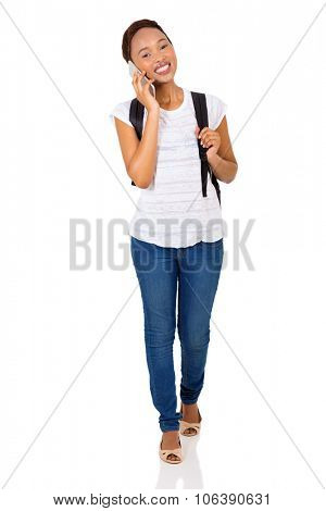attractive afro american college girl talking on mobile phone
