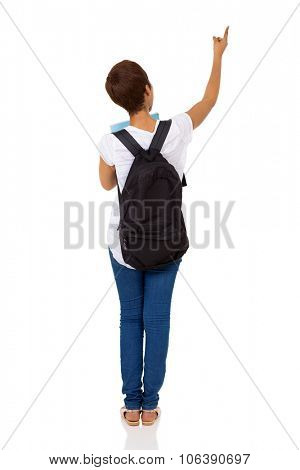 rear view of african college girl pointing empty space on white background