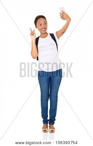 happy african american college girl taking a self portrait with smart phone