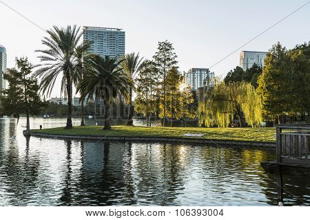Orlando Lake Eola in the evening with urban skyscrapers before sunset
