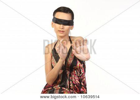 teenage girl tied with black band