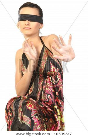woman tied with black band