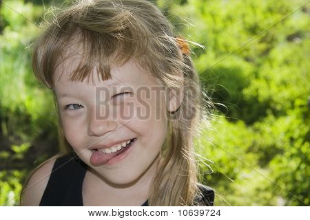 Little Girl Sticking Out Tongue.