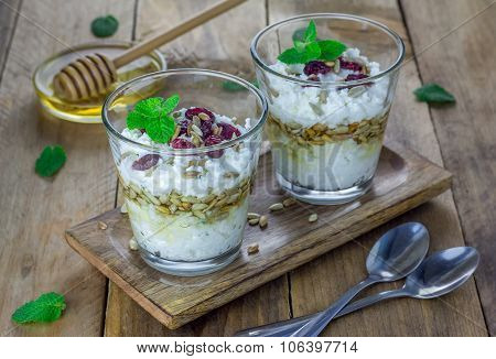 Ricotta Cheese Dessert With Honey, Sunflower Seeds And Mint, Garnished With Dry Cranberries