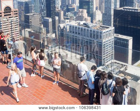 NEW YORK,USA - AUGUST 15,2015 : Tourists at an observation deck atop a skyscraper in New York City