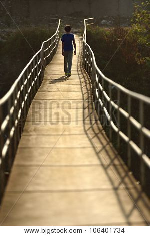 Walking Child On The Suspension Bridge